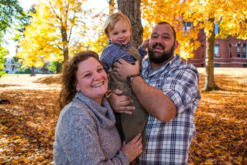 Портрет семьи осенью стоковое фото rf