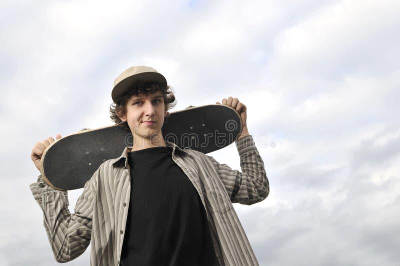 Портрет скейтбордиста стоковое фото