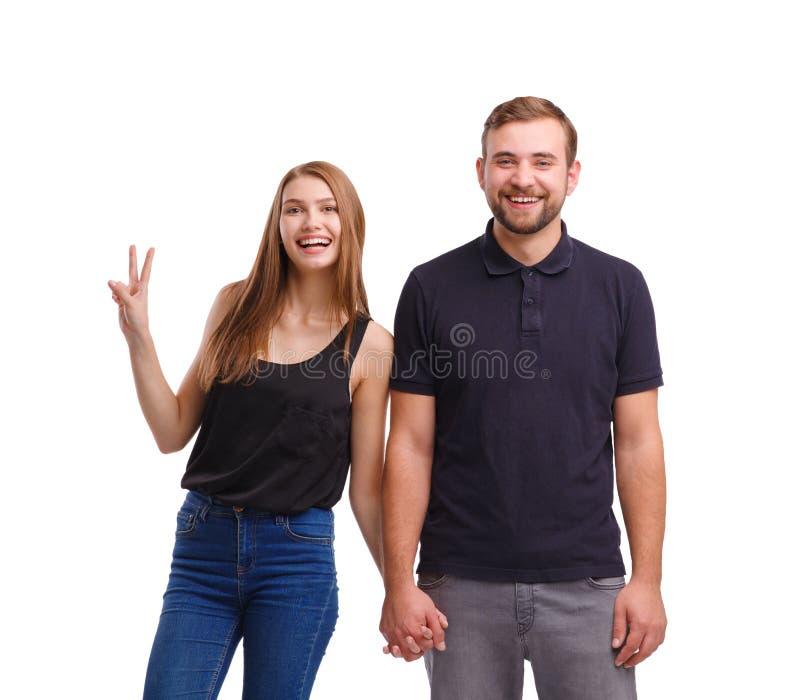 Портрет счастливых пар держа руки, изолированный на белой предпосылке стоковое изображение rf