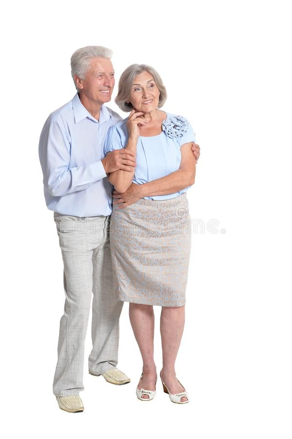 Портрет счастливых старших пар на белой предпосылке стоковая фотография