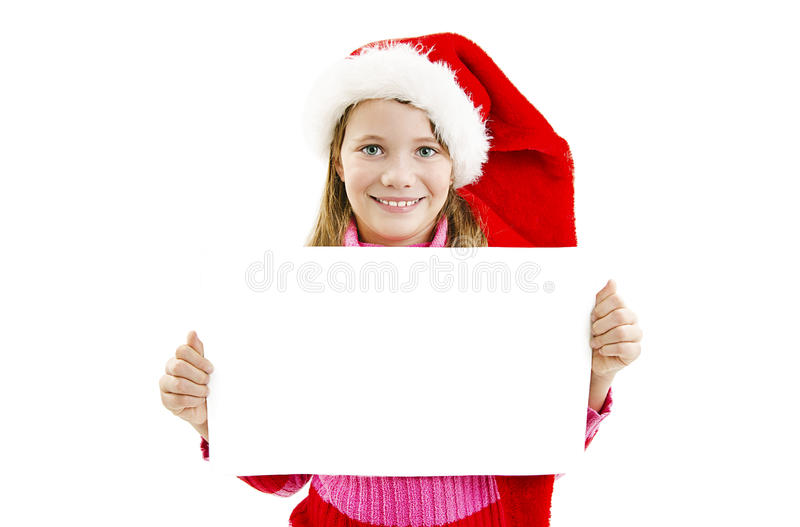 Портрет счастливой маленькой девочки в шляпе Санты с белой пустой доской стоковое изображение rf