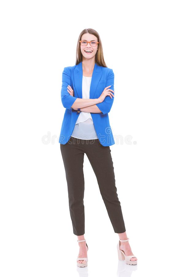Портрет уверенного положения молодой женщины изолированный на белой предпосылке стоковое фото