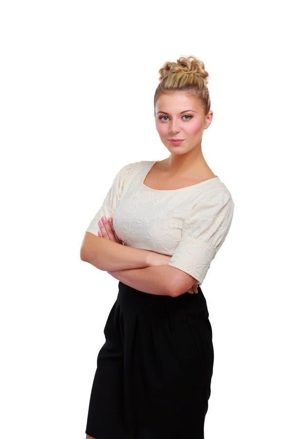 Портрет уверенно положения молодой женщины изолированный на белой предпосылке стоковые фотографии rf