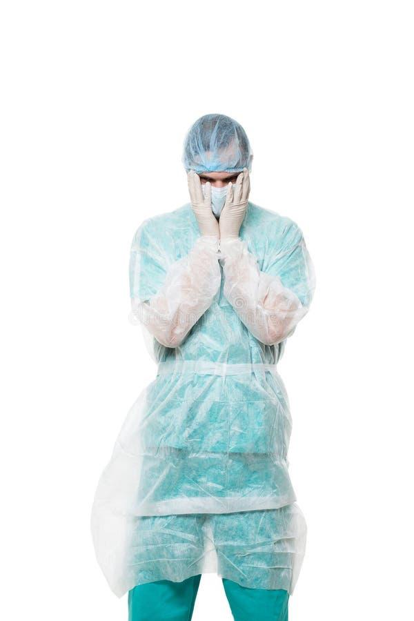 Портрет хирурга покрытая сторона с его руками Унылый стоковое фото rf