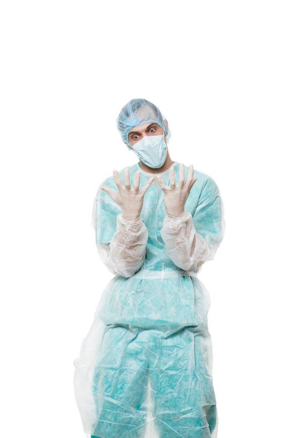 Портрет хирурга покрытая сторона с его руками Унылый стоковые фото