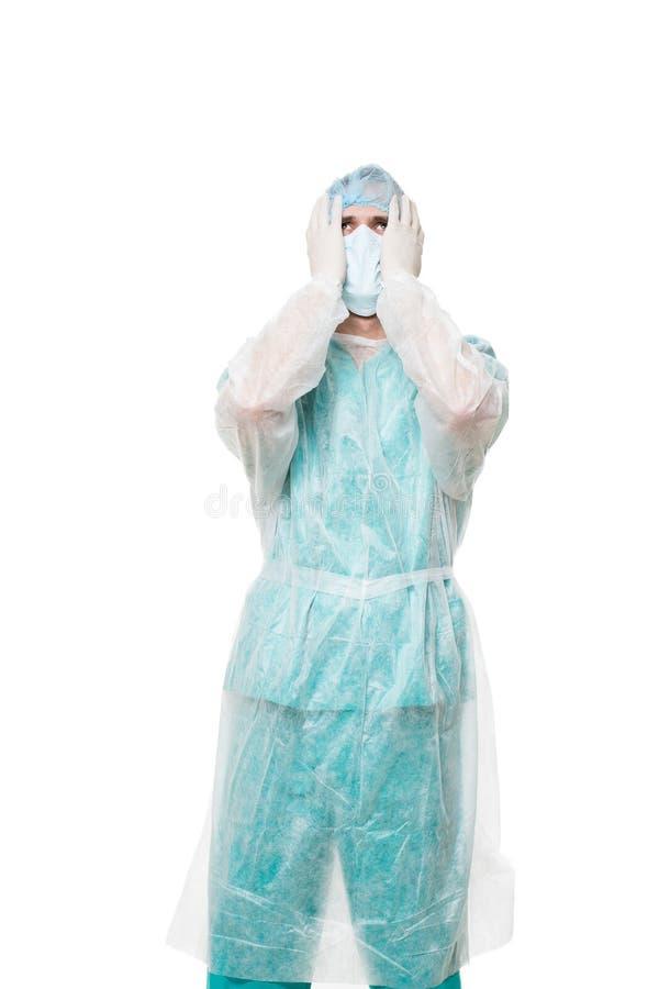 Портрет хирурга покрытая сторона с его руками Унылый стоковые фотографии rf