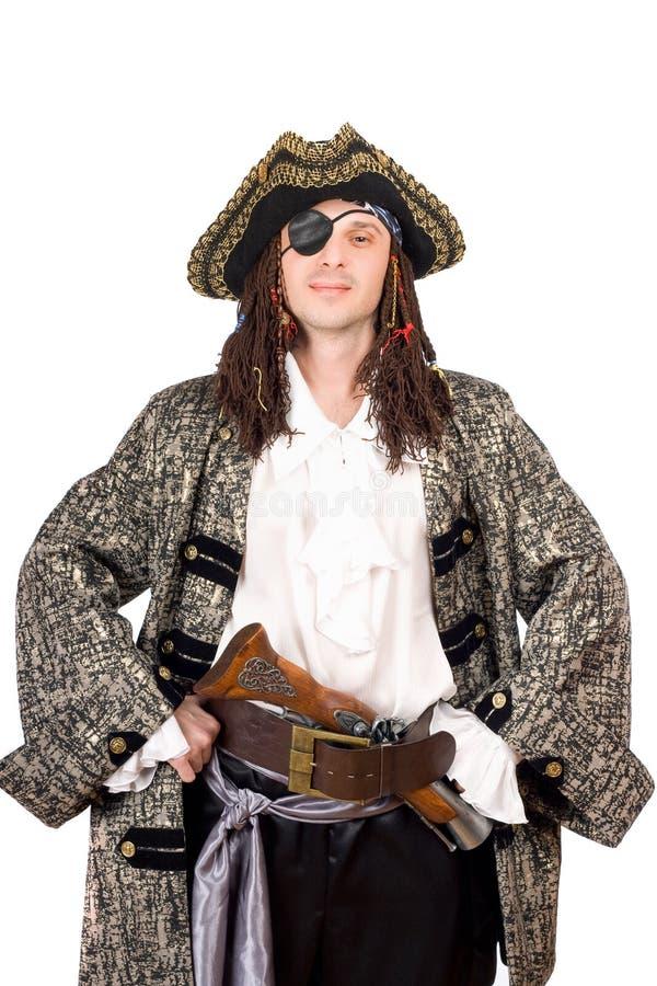 Портрет человека одетьнный как пират стоковое фото