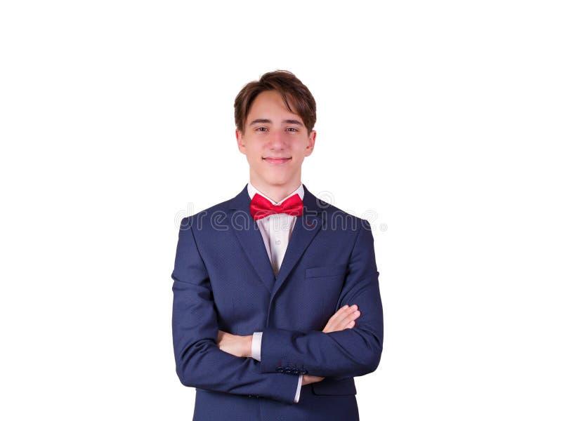 Портрет элегантного молодого человека в костюме и бабочке, изолированный на белой предпосылке стоковые фотографии rf
