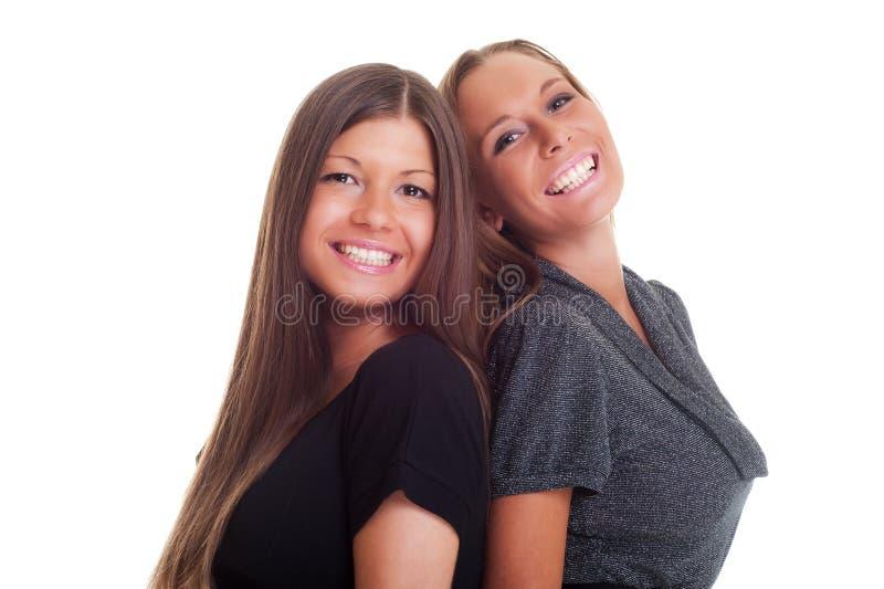 портрет 2 девушок счастливый стоковые изображения