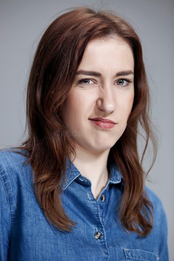 Портрет disgusted женщины стоковое фото rf