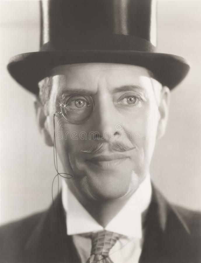 Портрет monocle человека нося и верхней шляпы стоковая фотография rf