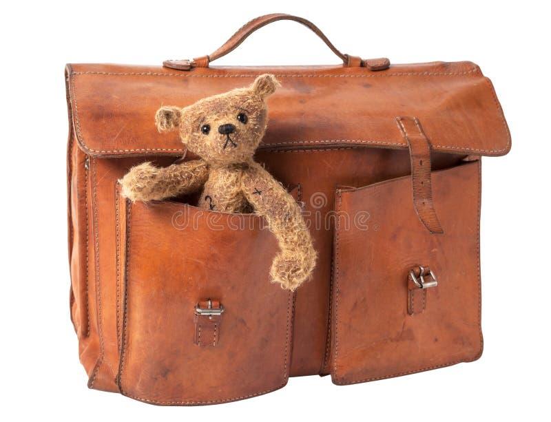 Портфель и плюшевый медвежонок стоковые изображения rf