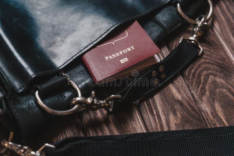 Портфель с пасспортом стоковое фото rf