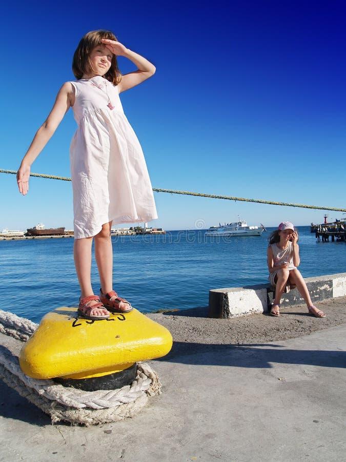порт девушок стоковая фотография