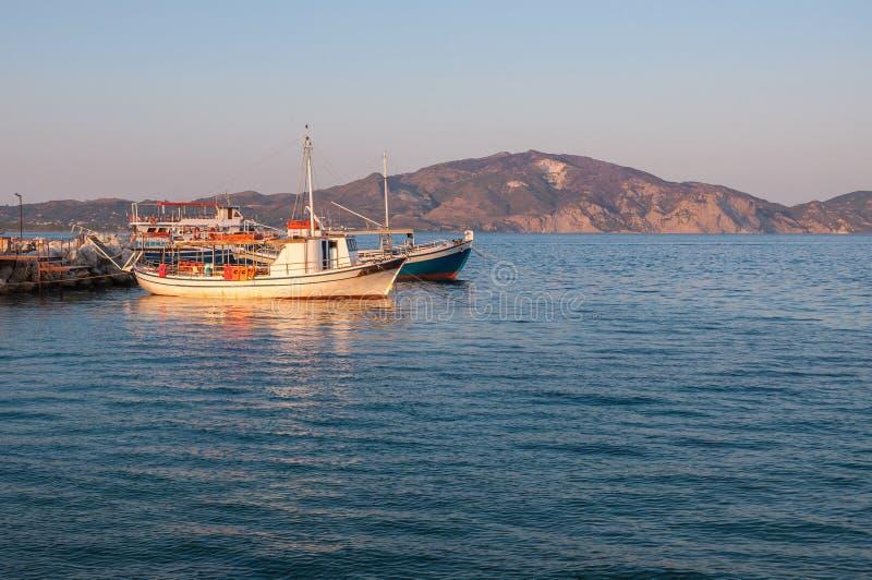 Порт Sostis ажио на заходе солнца стоковые фотографии rf
