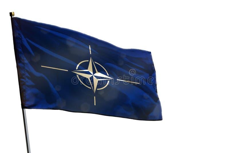 Порхая флаг НАТО на ясной белой изолированной предпосылке стоковое фото
