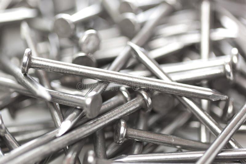 Посеребрите стальные ногти стоковое изображение