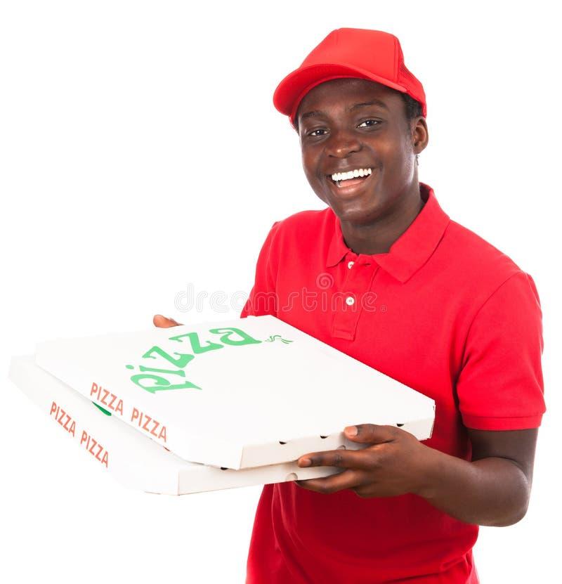 поставка мальчика наслаждается пиццей обеда вашей стоковая фотография