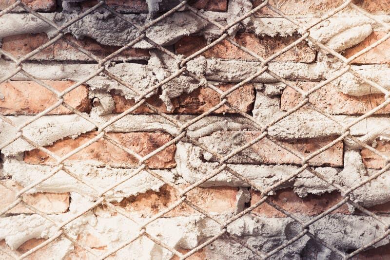 Постаретая предпосылка стены улицы, старая предпосылка текстуры красного кирпича стоковая фотография