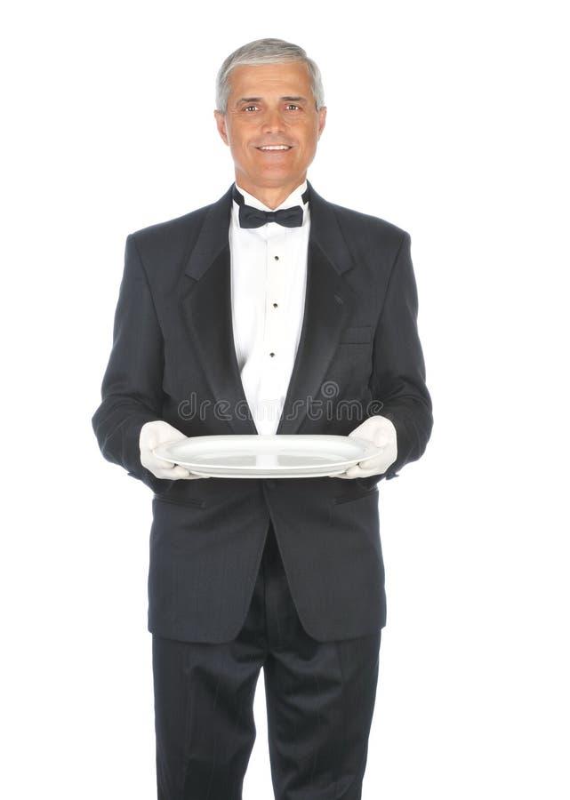 постаретый взрослым мыжской средний носить смокинга стоковое изображение