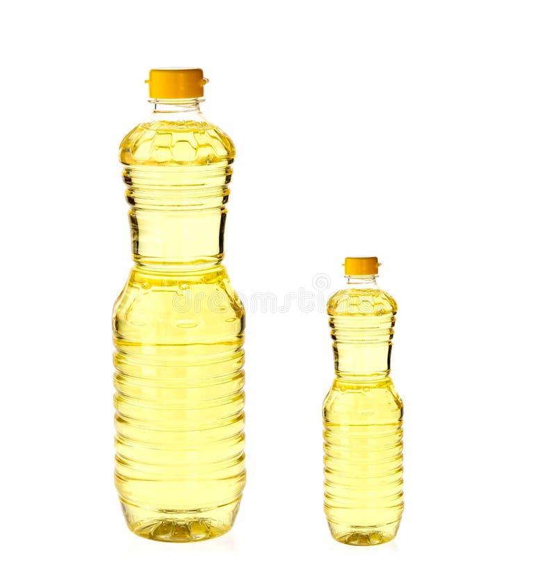 Постное масло для варить в бутылке изолированной на белизне стоковые изображения rf