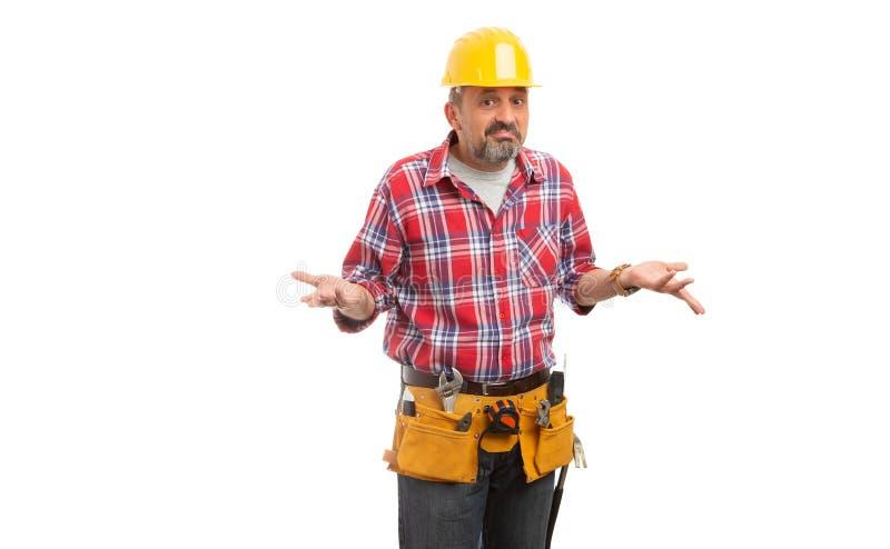 Построитель делая смущенные выражение и жест стоковое фото