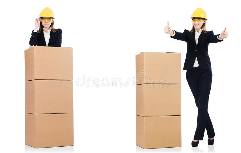 Построитель женщины с коробкой изолированной на белизне стоковая фотография