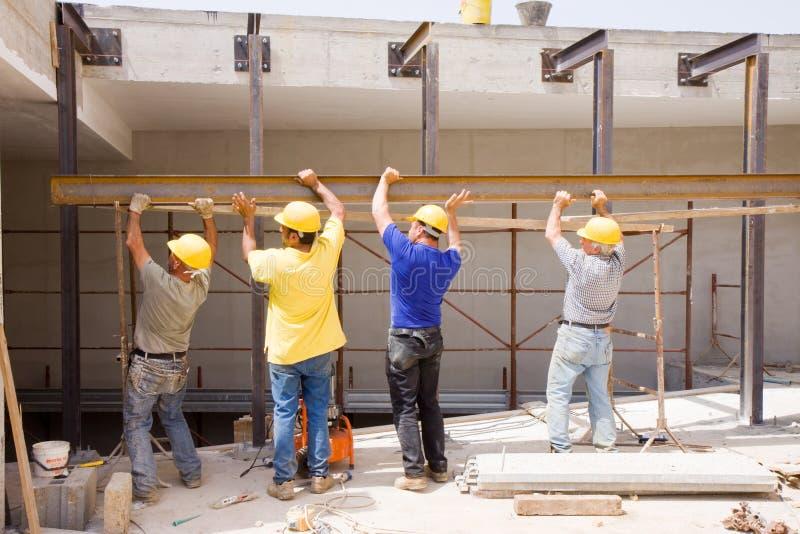 Построители на работе стоковые фото