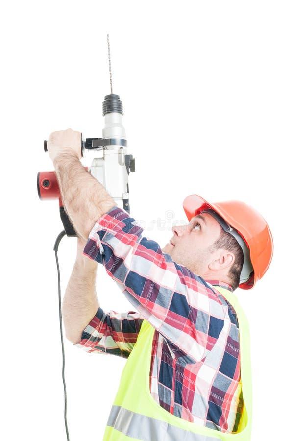 Построитель Porfessional используя машину сверла стоковые фотографии rf