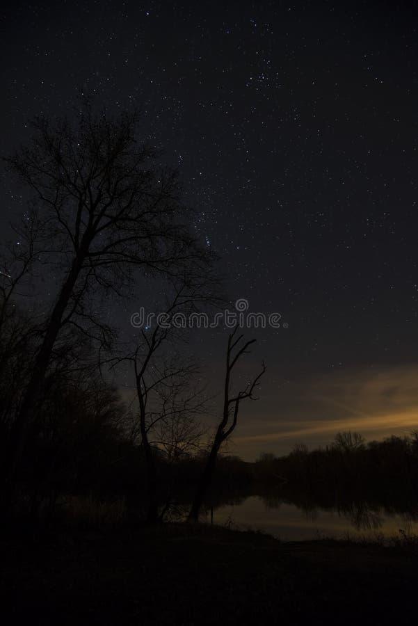Последние лучи солнечного света встречают звезды стоковое изображение rf