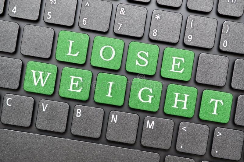 Потеряйте ключ веса на клавиатуре стоковое изображение rf
