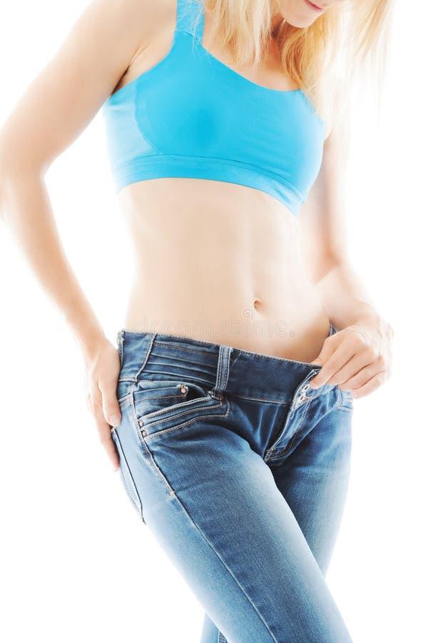 Потеря веса показанная свободные джинсы стоковые изображения