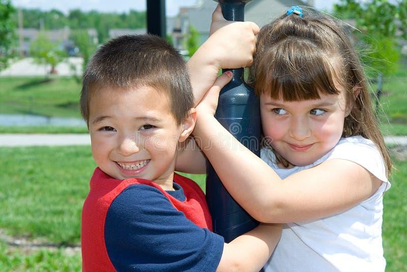 потеха детей имея парк стоковое фото rf