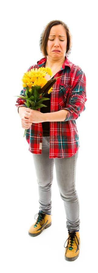 Download Потревоженная молодая женщина держа букет солнцецветов Стоковое Фото - изображение насчитывающей несчастно, обезумевший: 41652126