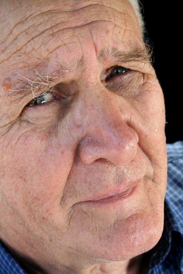 потревоженный старший человека стоковое фото