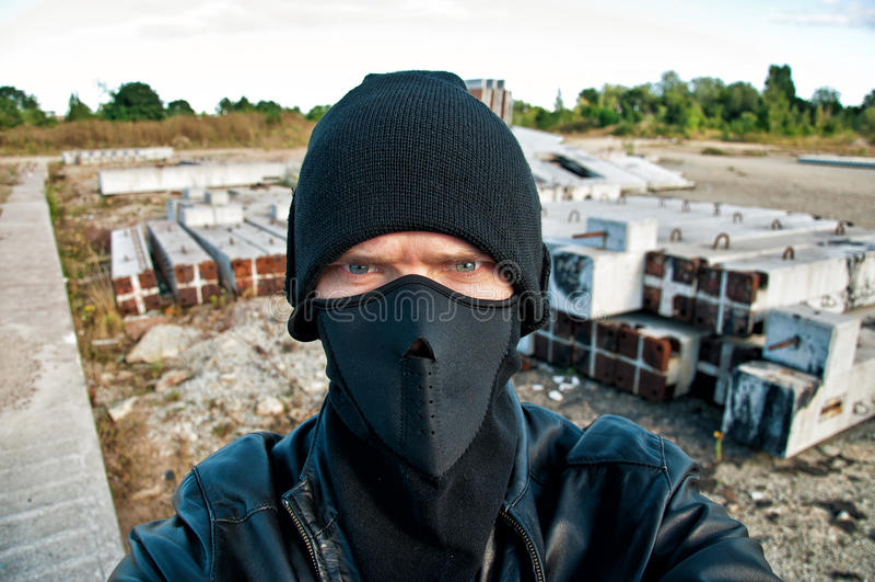 Похититель принимает камеру слежения стоковое изображение
