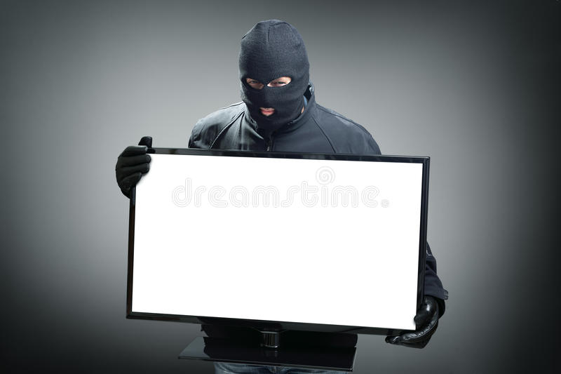 Похититель крадя монитор компьютера стоковое изображение