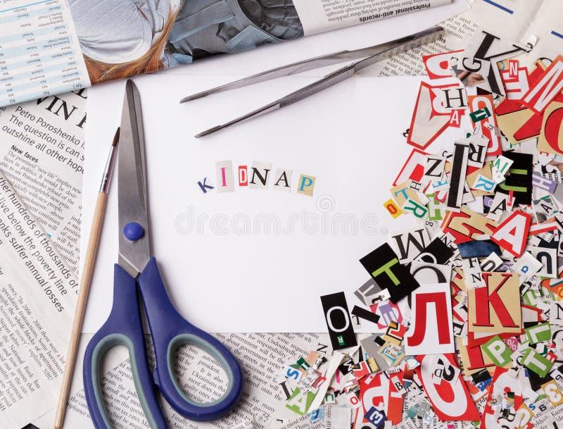 Похитьте надпись сделанную с отрезать вне письма стоковое фото rf