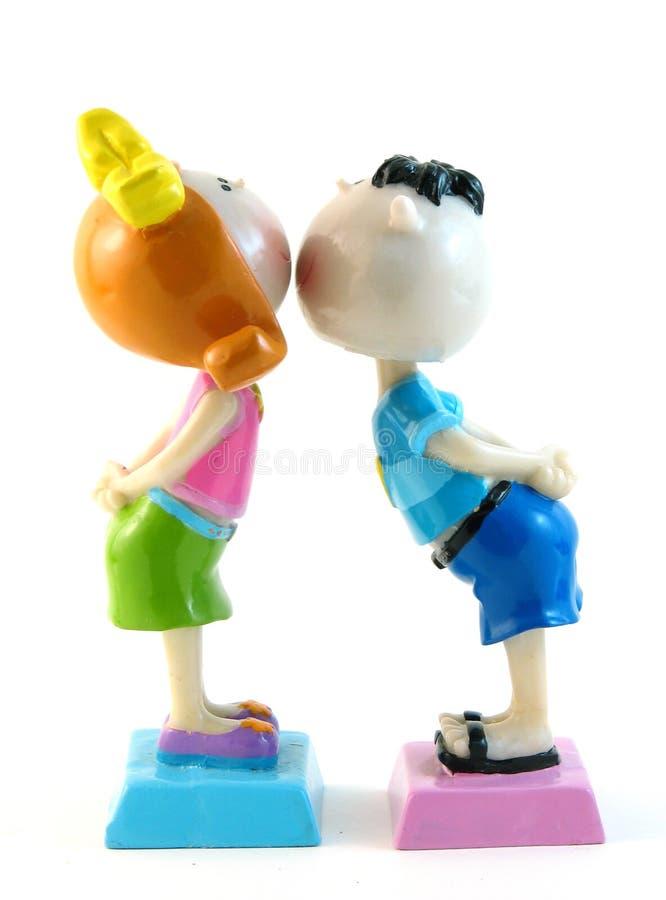 поцелуй девушки мальчика стоковое изображение rf