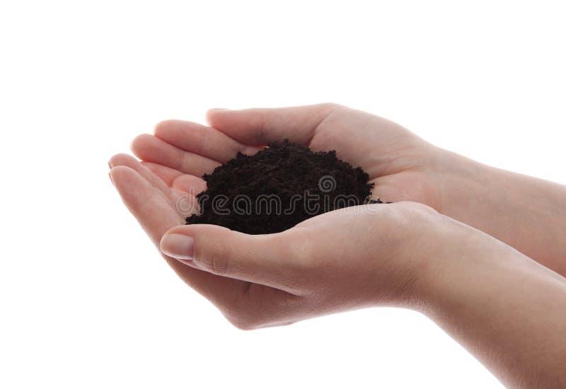 Почва в руках стоковая фотография