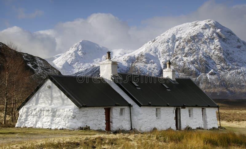 Почерните коттедж утеса, Glencoe, Шотландию. стоковая фотография