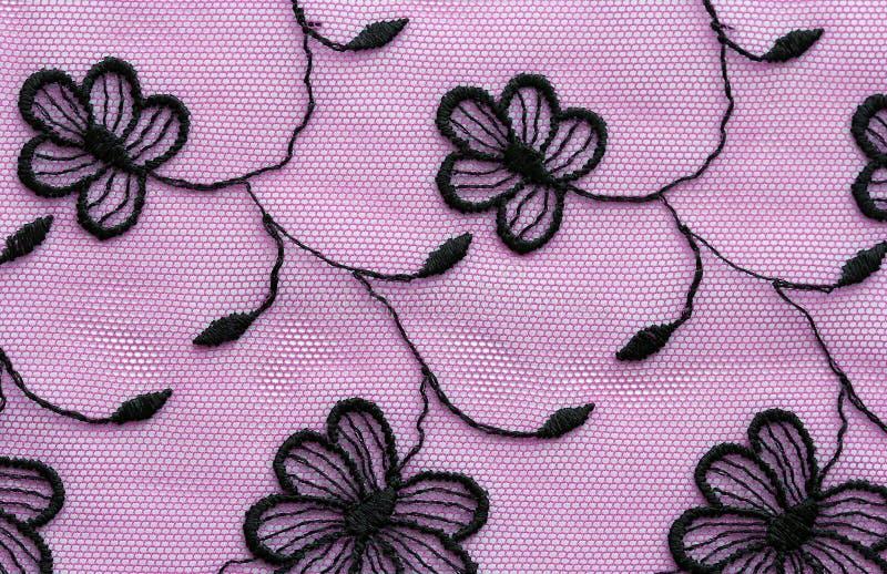 Почерните на съемке макроса текстуры розового шнурка цветков материальной стоковое изображение rf