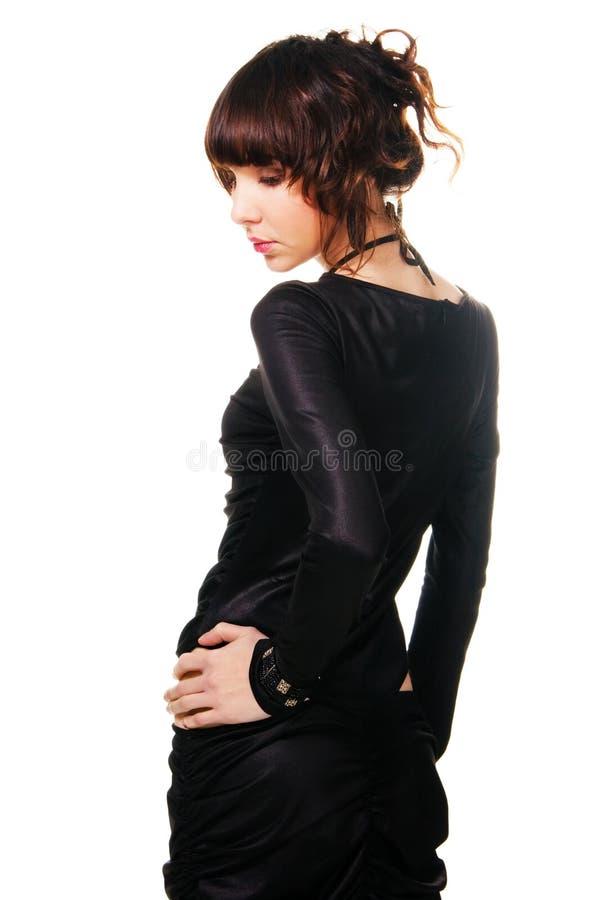 почерните сатинировку платья брюнет шикарную стоковое изображение rf
