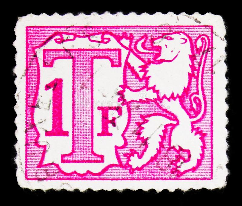 Почтовая марка, напечатанная в Бельгии, показывает Cijfer, Postage Due - Heraldic Lion Small Numeral serie, около 1985 стоковые изображения