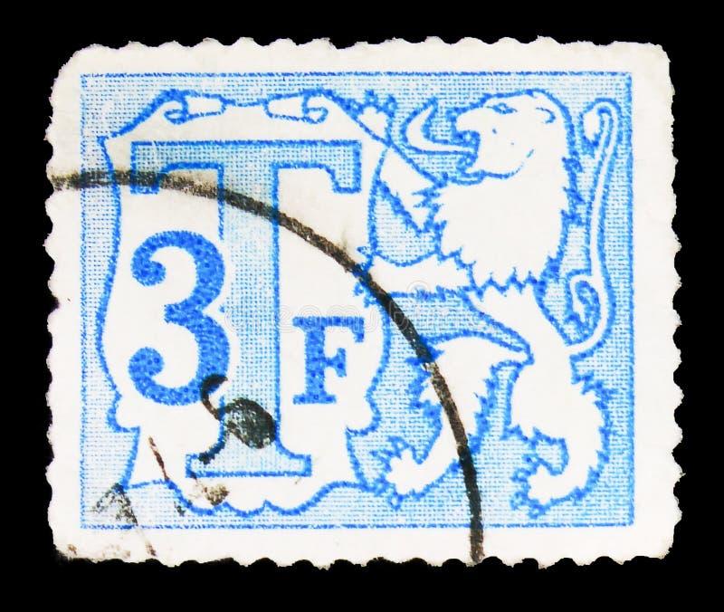 Почтовая марка, напечатанная в Бельгии, показывает Cijfer, Postage Due - Heraldic Lion Small Numeral serie, около 1985 стоковая фотография rf