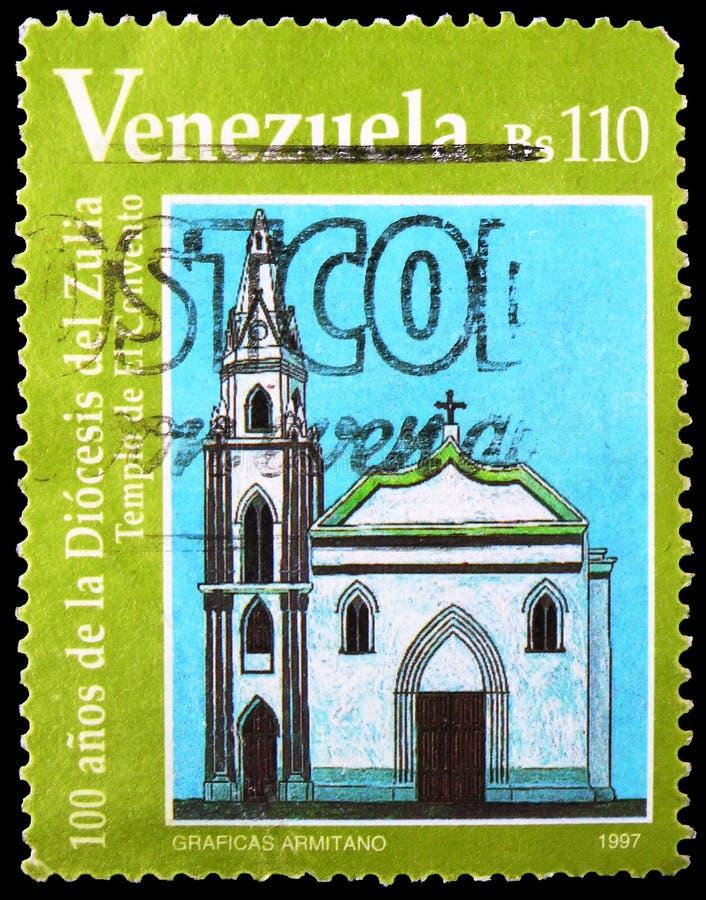 Почтовая марка, напечатанная в Венесуэле, показывает монастырь, епархию Зулии, столетие, около 1997 года стоковое фото