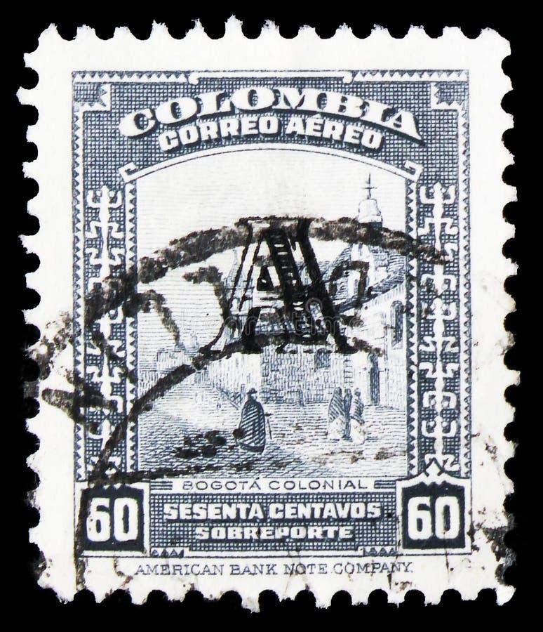 Почтовая марка, напечатанная в Колумбии, показывает улицу в Боготе - перепечатанная, 60 колумбийских центаво, Вопросы для авиаком стоковые фотографии rf