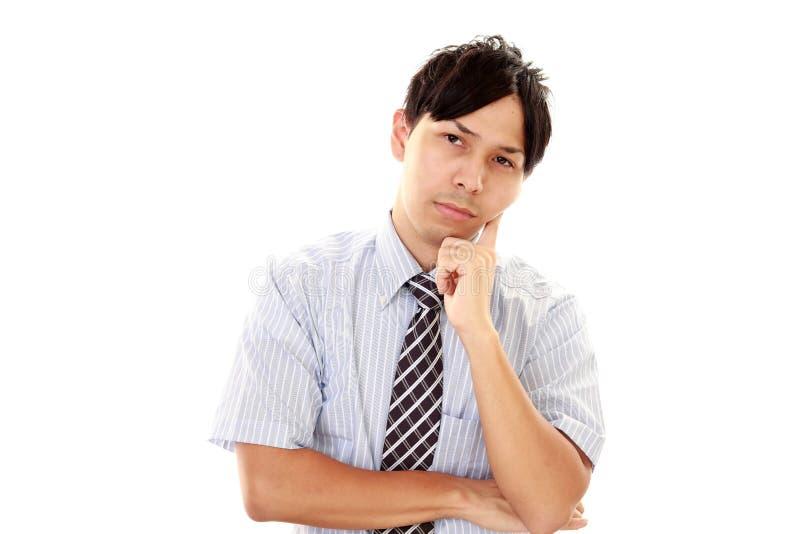 Подавленный азиатский бизнесмен стоковая фотография