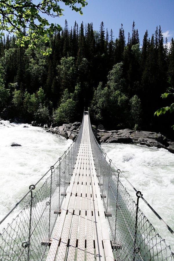 подвес человека моста стоковая фотография