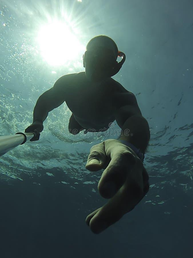 Подводный силуэт selfie стоковое фото rf